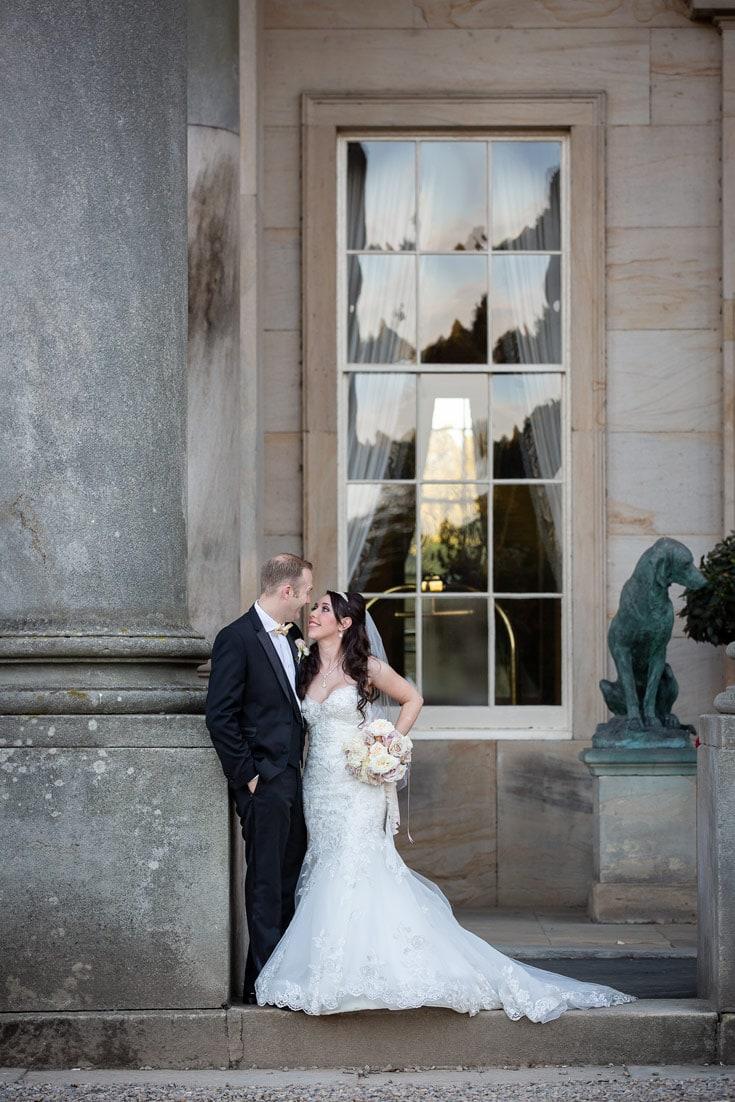 Bride and Groom kissing outside Wynyard Hall