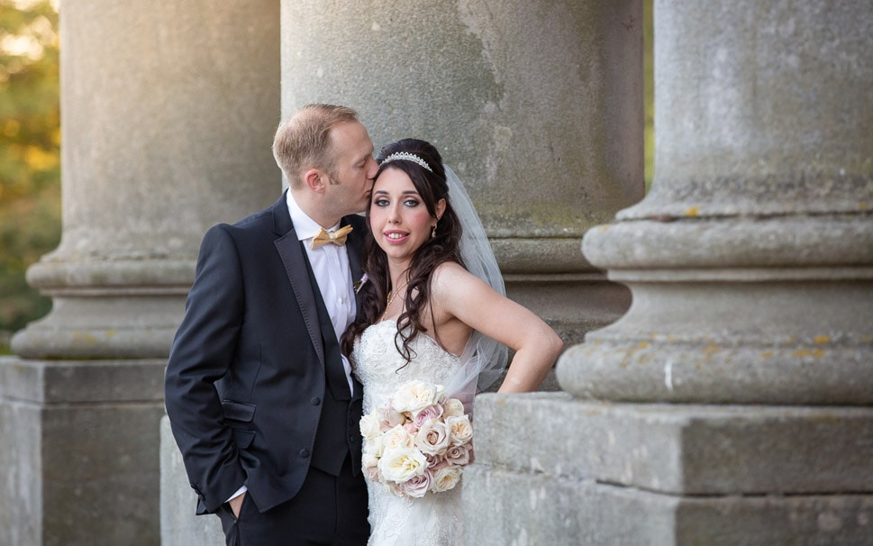 Groom Kissing Bride at Wynyard Hall