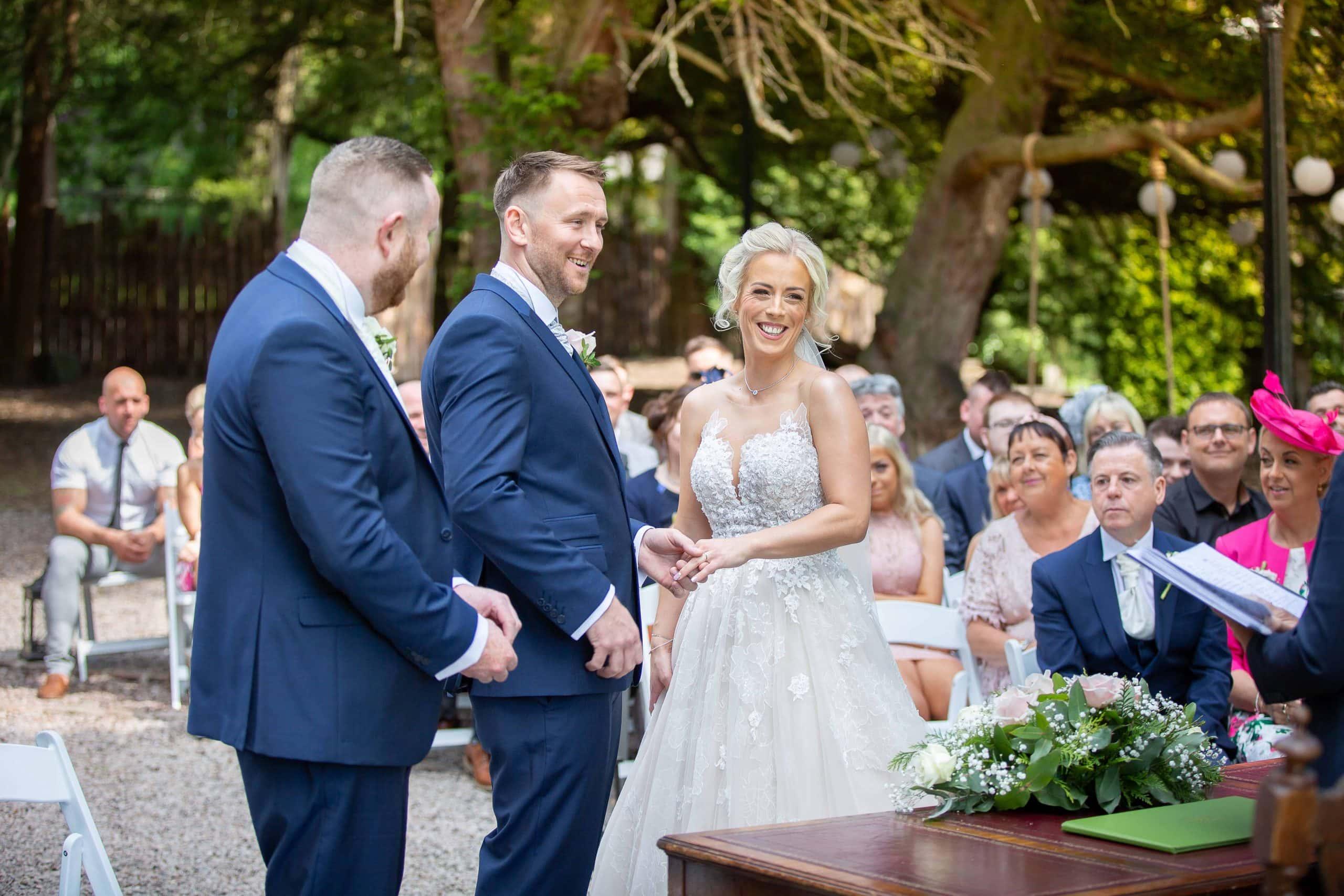 "Bride and groom saying ""I do"" at Beamish Hall"