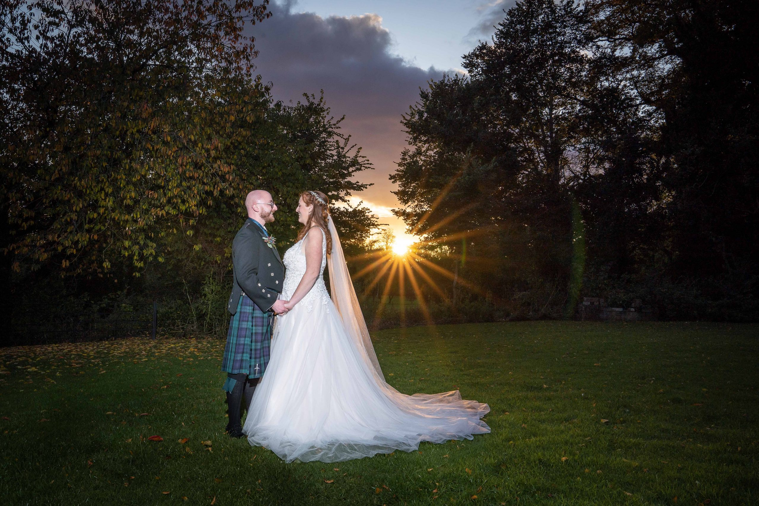 Bride and groom at sunset at Blackwell Grange