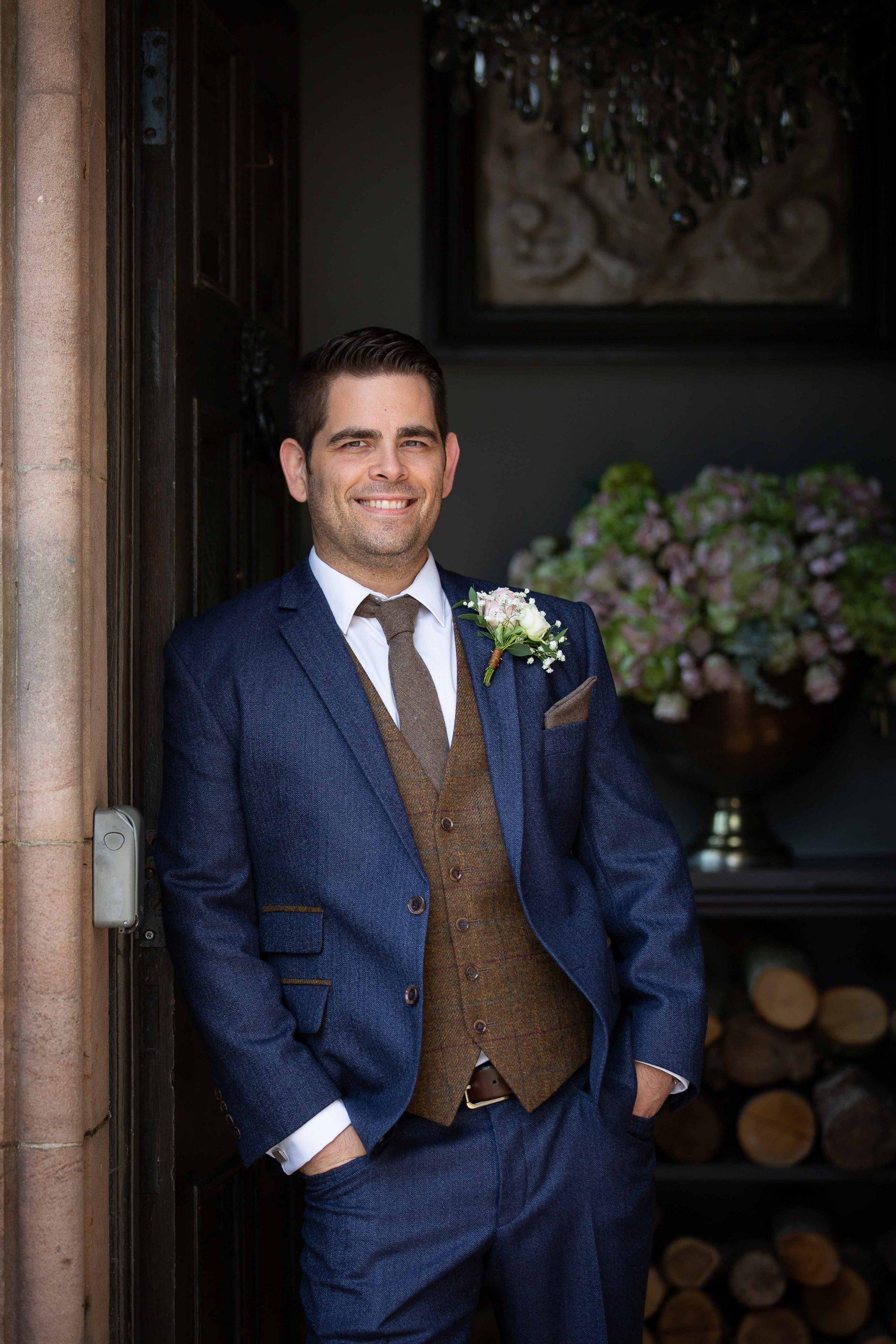 Groom before his wedding at Ellingham Hall