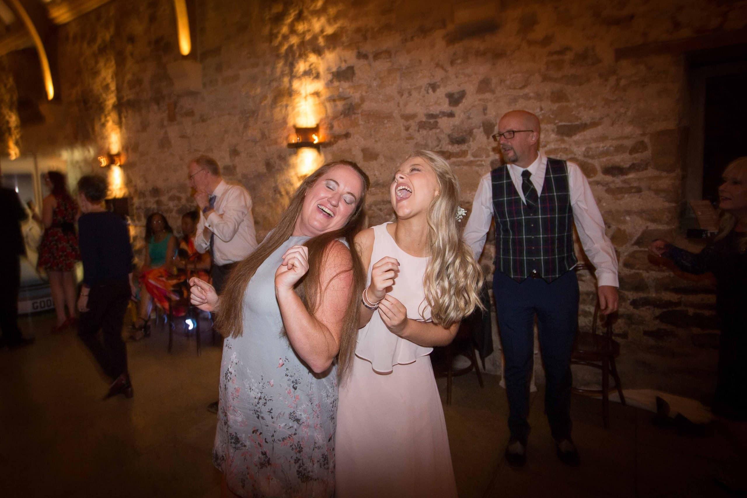 Guests dancing at Healey barn wedding
