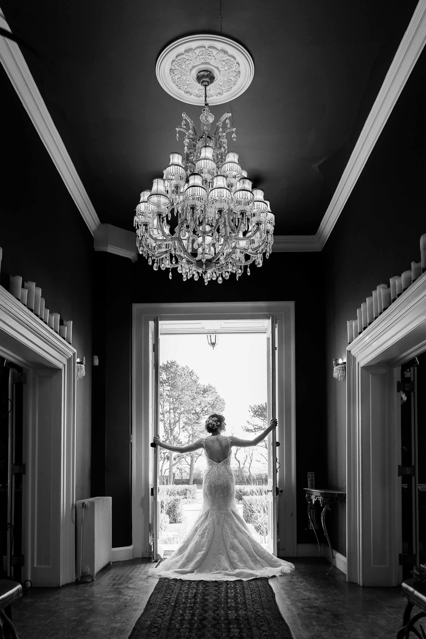 Black and white image of bride at Newton Hall
