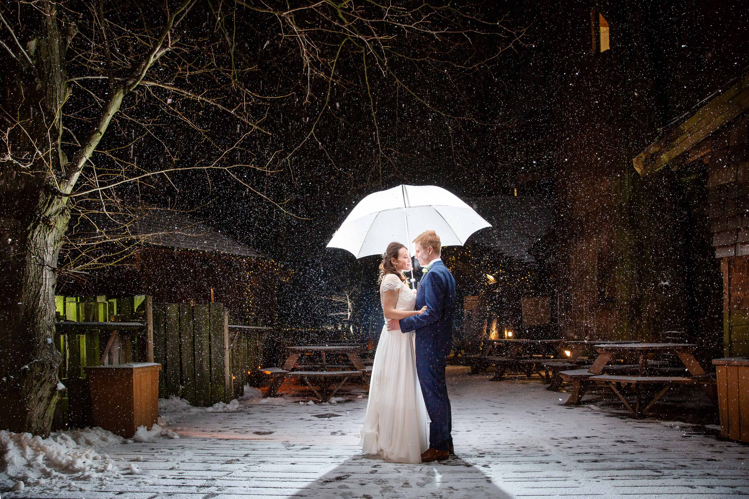 happy couple in the snow at Alnwic