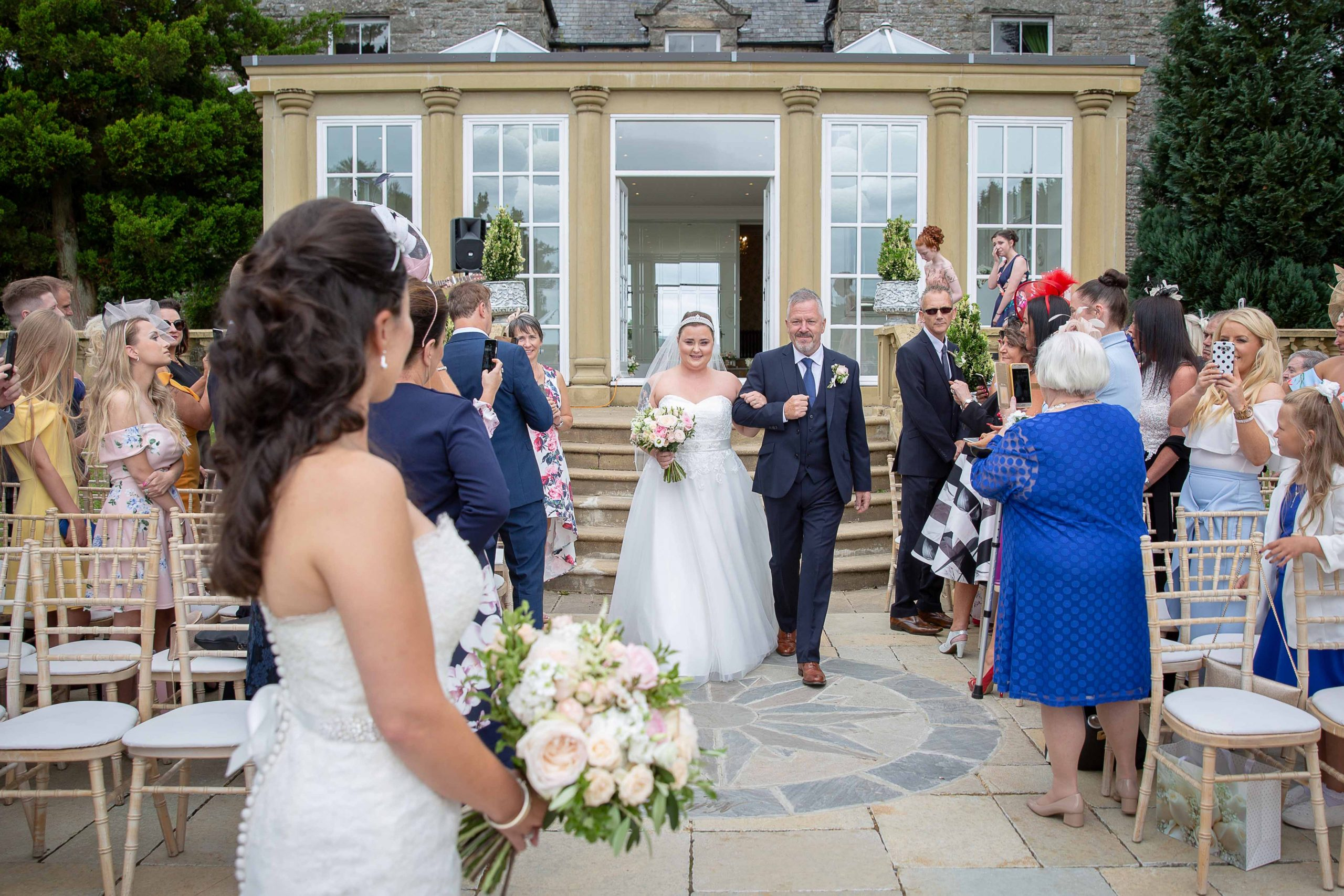 Bride walking down the aisle at Woodhill Hall
