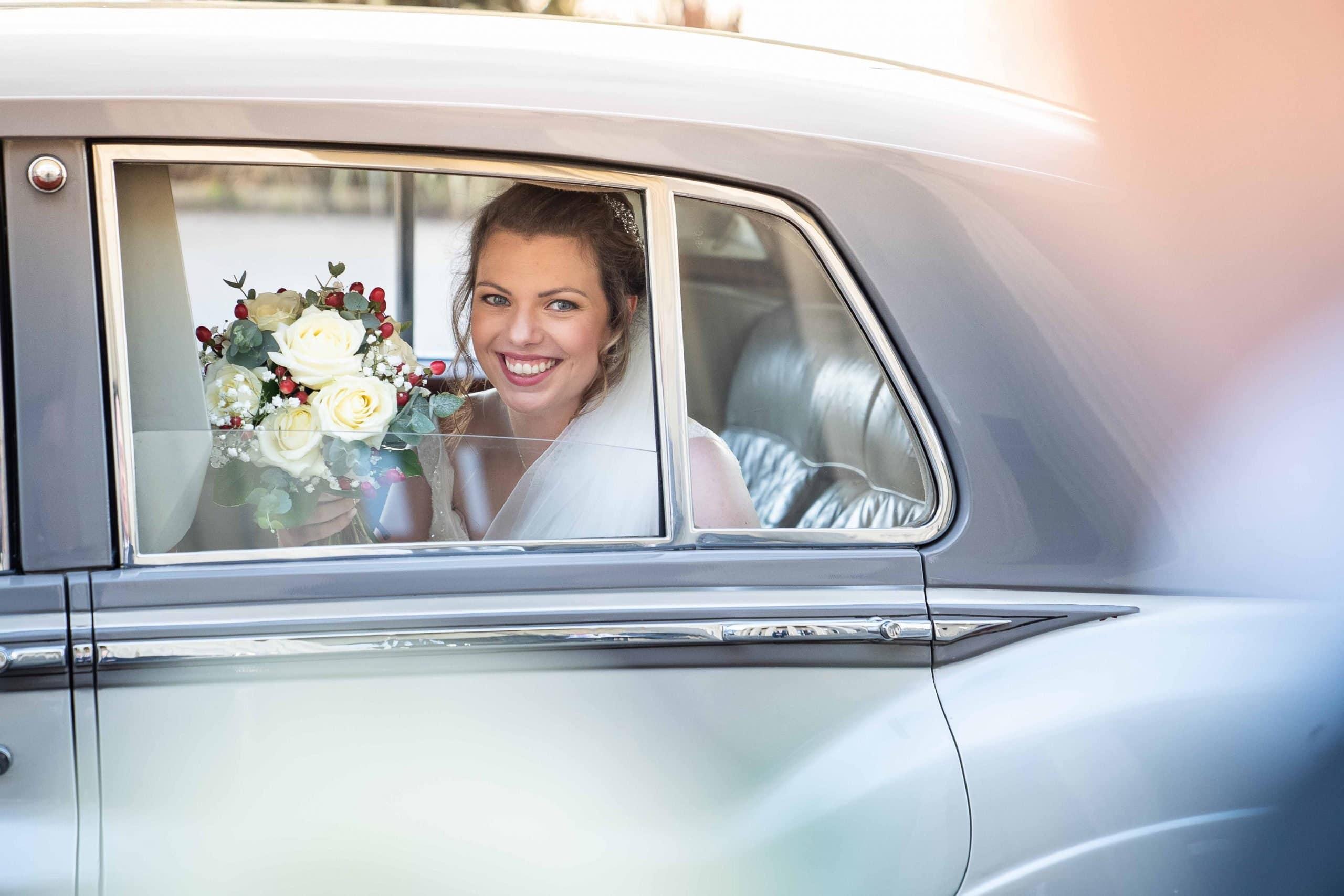 Bride in wedding car at Wylam Brewery