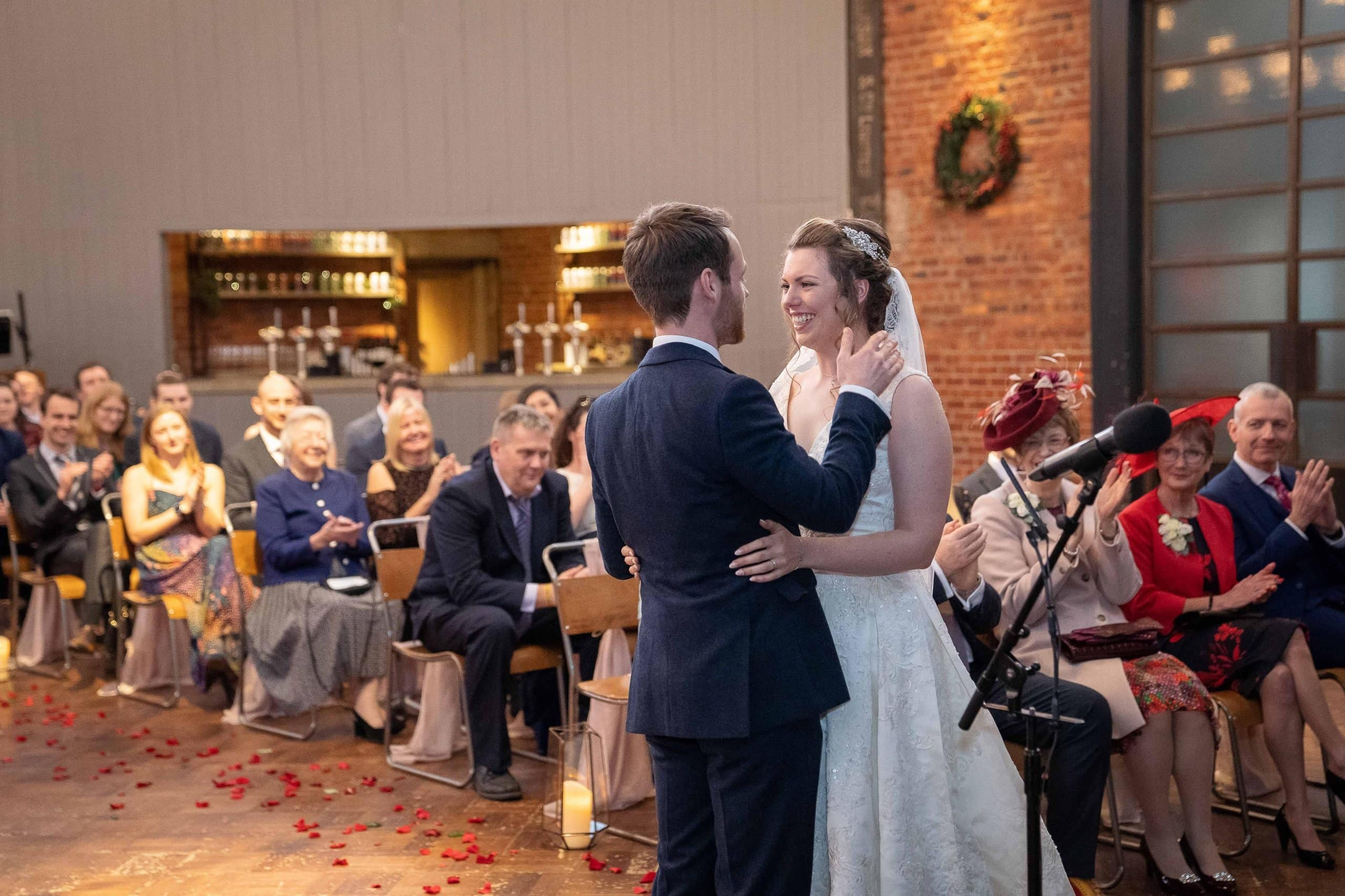 Brdie and groom saying I do at Wylam Brewery