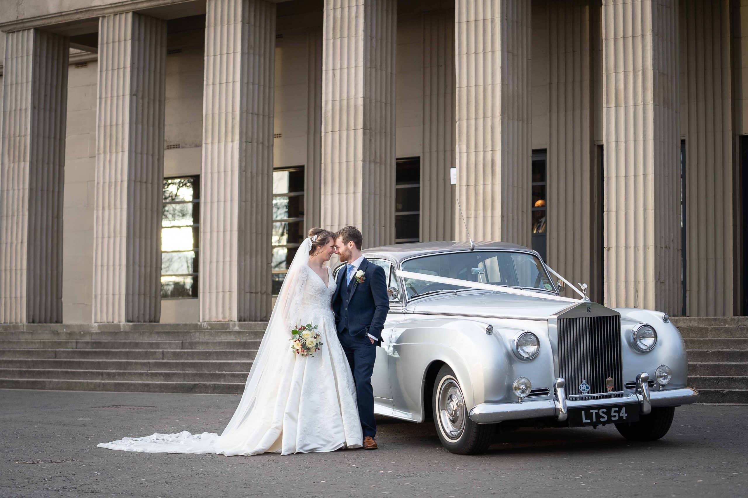 Bride and Groom next to wedding car at Wylam Brewery