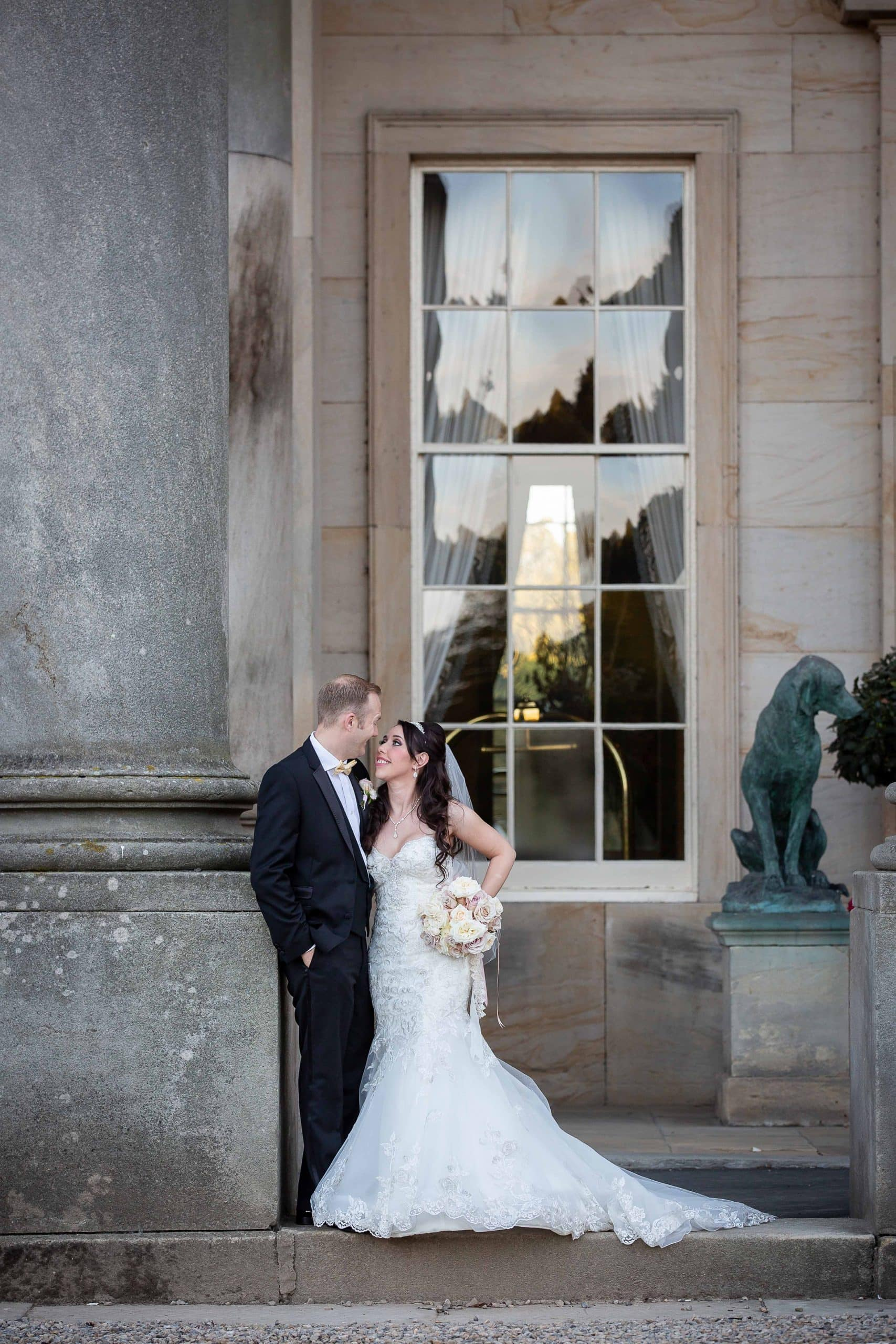 Bride and groom kissing in front of Wynyard Hall